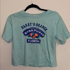 barry's orange shirt